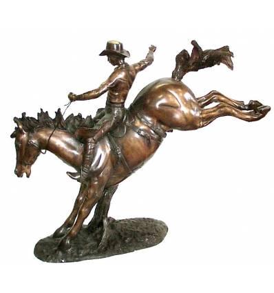 Sculpture de cavalier cowboy en bronze BRZ0984 ( H .109 x L :129 Cm ) Poids : 43 Kg
